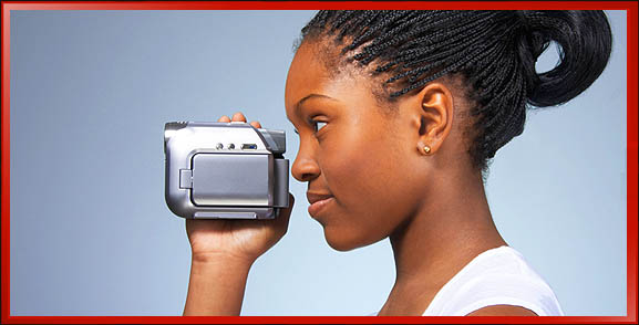 Woman Holding Camera One Hand