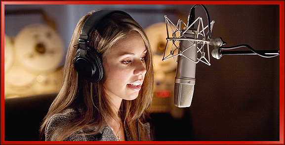 Woman Speaking Voice Over into Microphone