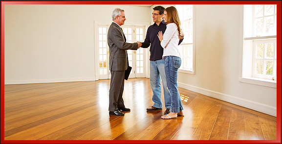 Real Estate Agent Touring Home with Young Couple