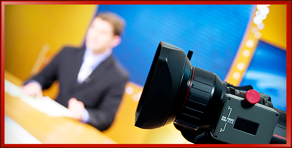 Businessman in Suit Interview and Camera Lens