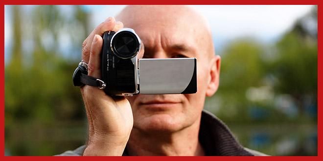 man-with-consumer-camera